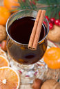 Mulled wine winter hot drink with cinnamon dried orange slices tangerine and walnut Royalty Free Stock Photography
