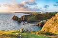Mullion cove in cornwall clifftops on the south west coast path overlooking on the lizard penisula Stock Photos