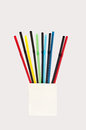 Multi color flexible drinking straws on white in wooden base Stock Photos