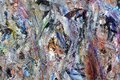 Multi-color multi-layer background. Smears of semi-dry paint. Old art palette. Motley dabs of paint. Mixing color spots on the can Royalty Free Stock Photo