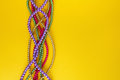 Multi color Mardi Gras beads on paper background. Top view Royalty Free Stock Photo