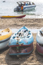 Multi color rowboat or sea kayaks on beach with copy space. Royalty Free Stock Photo
