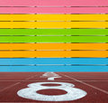Multi Color wooden wall with running lane floor Royalty Free Stock Photo