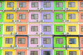 Multi colored apartment building background Stock Photos