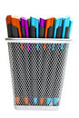 Multi-colored ballpoint pens in pencil holders Royalty Free Stock Photo