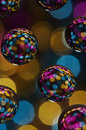 Multi colored balls against defocused light background Stock Image