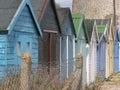 Multi Colored Beach Huts Along...