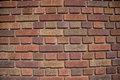 Multi-colored brick wall Stock Images