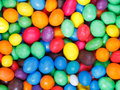 Multi colored chocolate candy dragees background from close up Stock Images