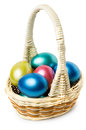 Multi colored easter eggs in basket with handle on white background Stock Image