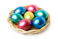 Multi colored easter eggs in basket on white background Stock Images