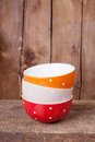Multi colored empty big polka dot bowls: red, beige and orange Stock Photography