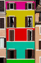 Multi colored facade building windows opened and closed with open a with a for layers of floors historic center of Royalty Free Stock Image