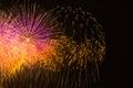 Multi colored fireworks in the dark night sky Stock Photo