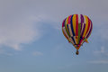 Multi-colored hot air balloon floats through the sky at dusk at Warren County Farmer`s Fair, Harmony, New Jersey, on 8/1/17