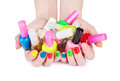 Multi colored jelly sweets in the hands with a bright nail polish isolated Stock Images