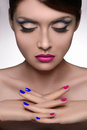 Multi colored manicure portrait of beautiful women holding her woman fingers crossed showing while isolated Stock Photo