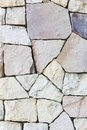 Multi colored and multi sized pale rocks wall grunge texture ba background Stock Photography