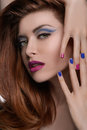 Multi colored nails portrait of beautiful women showing her mul woman manicure and looking at camera Royalty Free Stock Images