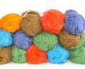 Multi colored skeins of yarn for knitting skeinsof stacked one upon the other in the background Royalty Free Stock Image