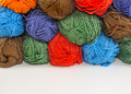 Multi colored skeins of yarn for knitting stacked one upon the other Royalty Free Stock Photos