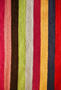 Multi colored stripey woolen rug of many colors Stock Photos