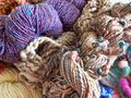 Multi-colored wool art yarn of different varieties close-up. Royalty Free Stock Photo