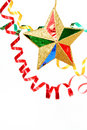 Multi-coloured celebratory tinsel and christmas star on a white Royalty Free Stock Photo