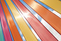 Multi coloured ribbons lit bright sunlight against summer sky Royalty Free Stock Photo