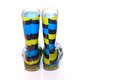 Multi coloured wellington boots on white with copy space Royalty Free Stock Photos