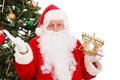 Multi cultural interfaith holidays santa standing in front of a christmas tree holding a menorah Stock Photography