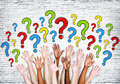 Multi ethnic arms outstretched to ask questions Stock Photography