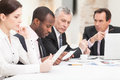 Multi ethnic business people discussing work Royalty Free Stock Photo
