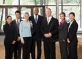 Multi-ethnic co-workers posing in lobby Royalty Free Stock Photo