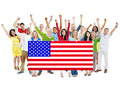 Multi-Ethnic Group Of People With American Flag Royalty Free Stock Photo