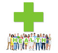 Multi ethnic group of people holding health alphabet to form Stock Photography