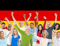 Multi-Ethnic People Arms Raised and German Flag Royalty Free Stock Photo