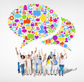 Multi ethnic people with arms raised and social networking symbols above Royalty Free Stock Images