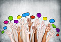 Multi ethnic people s hands raised with speech bubble Royalty Free Stock Image