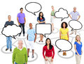 Multi ethnic people and a theme of connection group with speech bubbles for copy space Stock Photo
