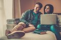Multi ethnic students couple preparing for exams young in home interior Stock Images