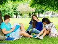 Multi ethnic students in a park group of city Stock Images