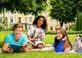Multi ethnic students in a park group of city Royalty Free Stock Image