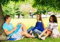 Multi ethnic students in a park group of city Royalty Free Stock Images