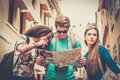 Multi ethnic tourists in old city friends with map Royalty Free Stock Photography