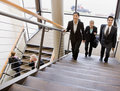 Multi-ethnic workers ascending office stairs Royalty Free Stock Photo