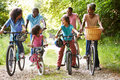 Multi generation african american family on cycle ride outdoors having fun Royalty Free Stock Image
