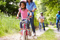 Multi generation african american family on cycle ride wearing helmets having fun Stock Image