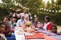 Multi generation black family having a 4th July garden party Royalty Free Stock Photo