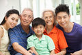 Multi-Generation Chinese Family Relaxing At Home Royalty Free Stock Photo